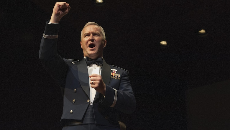 "Col. (Ret.) Larry H. Lang, former U.S. Air Force Heritage of America Band director, shouts out, ""Give her the Gun!"" during the playing of the Air Force Song during a USAF HOAB 75th Anniversary Band Concert at the Ferguson Center for the Arts in Newport News, Va., Oct. 1, 2016. In 2005, Lang was inducted into the prestigious American Bandmasters Association. He is also a member of numerous musical associations and is active as a guest conductor and clinician throughout the United States and abroad. (U.S. Air Force photo by Staff Sgt. Nick Wilson)"