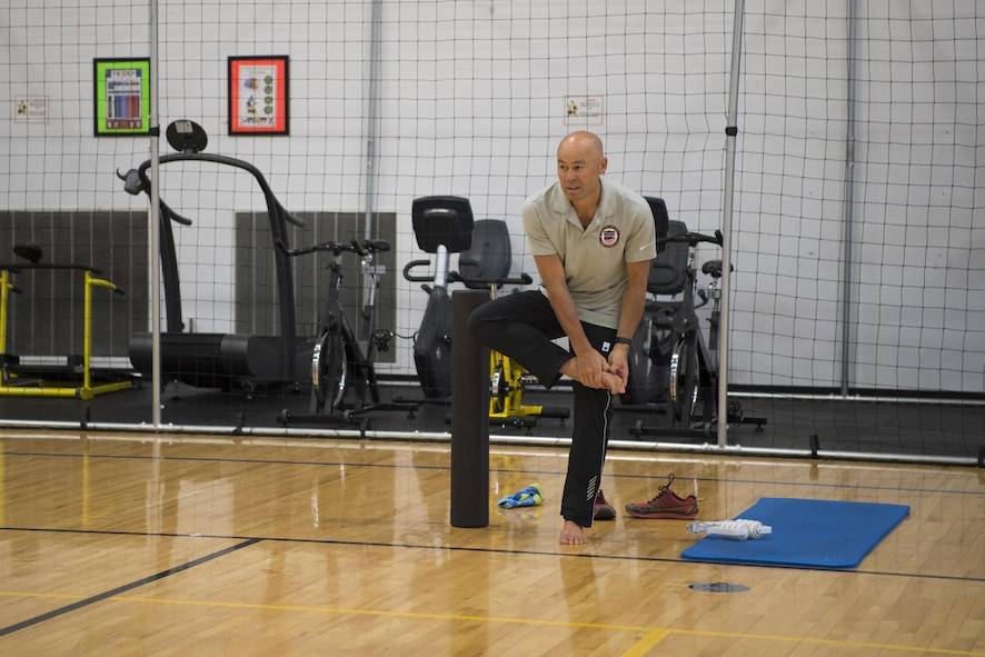 "Ian Adamson, president of Healthy Running, demonstrates ways runners can extend their big toe during a natural running form clinic at F.E. Warren Air Force Base, Wyo., Oct. 6, 2016. Toe extensions are used to increase the range of motion of the foot during running. ""We talked about nutrition, longevity, health, lifestyle and being functionally fit,"" Adamson said. ""It's important for their personal and professional lives."" (U.S. Air Force photo by Staff Sgt. Christopher Ruano)"