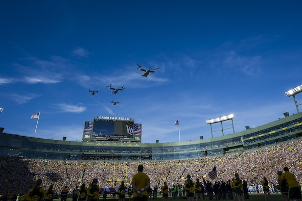Four CV-22 Osprey aircraft with the 8th Special Operations Squadron from Hurlburt Field, Fla., flyover Lambeau Field, Wis., during the final moments of the national anthem, Oct. 16, 2016. The flyover marks the first time that the 8th SOS has conducted a flyover of an NFL game. The Osprey is a tiltrotor aircraft that combines the vertical takeoff, hover and vertical landing qualities of a helicopter with the long-range, fuel efficiency and speed characteristics of a turboprop aircraft. (U.S. Air Force photo by Airman 1st Class Joseph Pick)