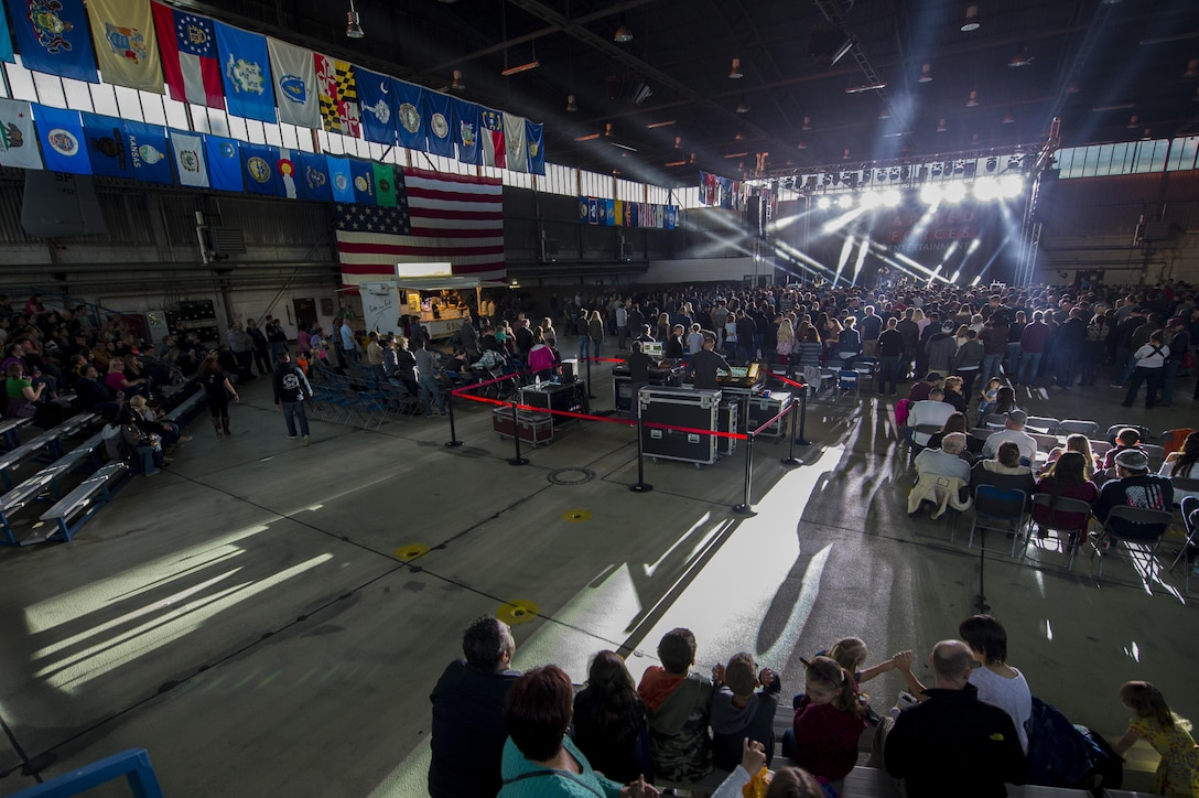 Sabers watch a concert performed by the American rock band, 3 Doors Down, inside Hangar 1 at Spangdahlem Air Base, Germany, Oct. 16, 2016. The free show was a part of the Armed Forces Entertainment tour, an Air Force command operation, which brings entertainment to U.S. military personnel serving overseas. (U.S. Air Force photo by Airman 1st Class Preston Cherry)