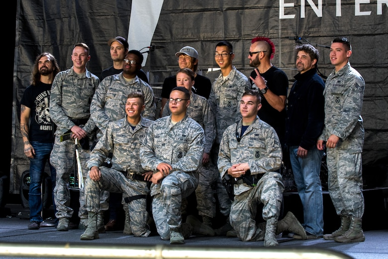 Airmen from the 52nd Fighter Wing at Spangdahlem Air Base, Germany pose with members of the American rock band, 3 Doors Down, before a concert inside Hangar 1 at Spangdahlem, Oct. 16, 2016. Some Sabers qualified for credentials to meet and have their pictures taken with the band. The band was a part of the Armed Forces Entertainment tour, an Air Force command operation, which brings entertainment to U.S. military personnel serving overseas. (U.S. Air Force photo by Airman 1st Class Preston Cherry)