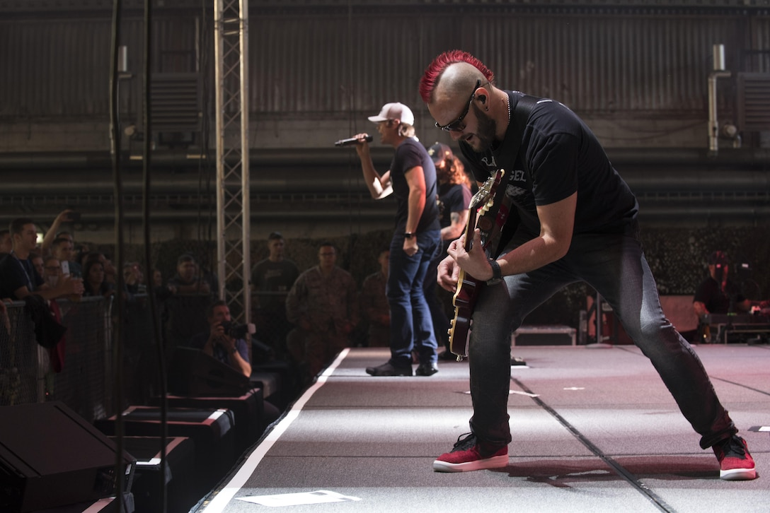 Members of 3 Doors Down, an American rock band from Escatawpa, Miss., perform a show inside Hangar 1 at Spangdahlem Air Base, Germany, Oct. 16, 2016. The band formed over 20 years ago. This concert marks its third time touring with Armed Forces Entertainment, an Air Force command operation, which brings entertainment to U.S. military personnel serving overseas. (U.S. Air Force photo by Airman 1st Class Preston Cherry)