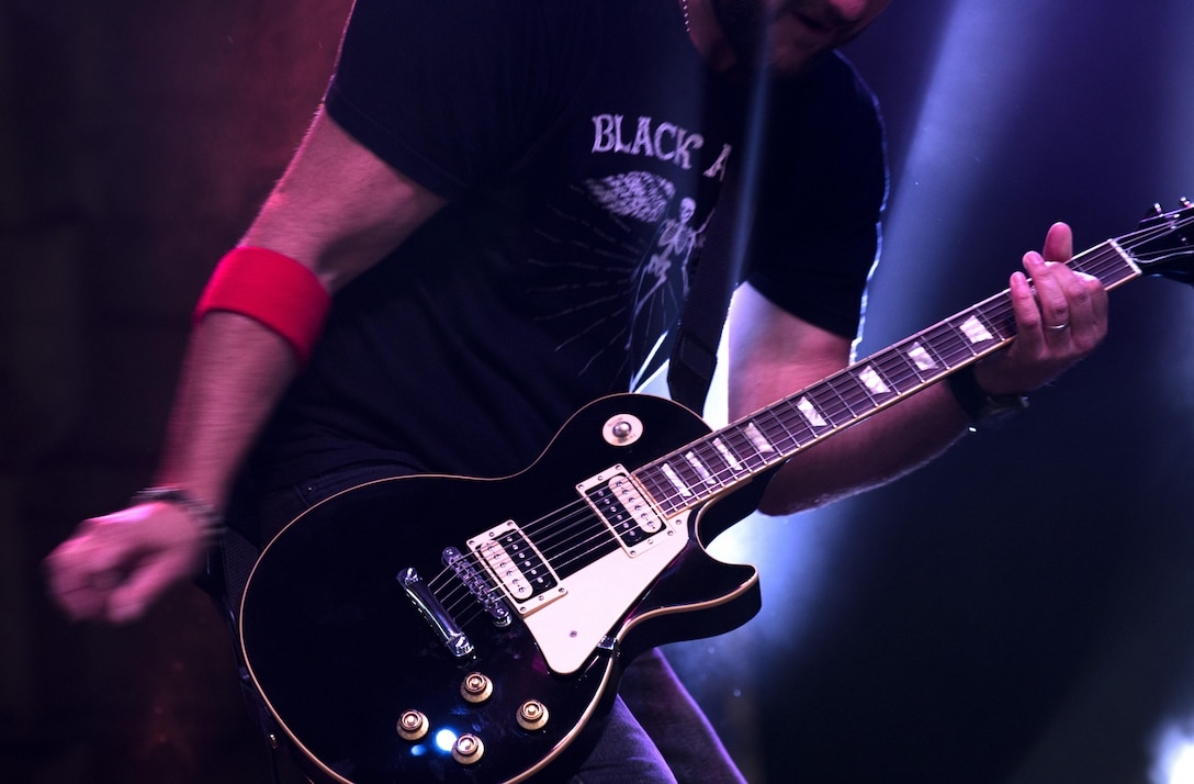 A member of the American rock band, 3 Doors Down, plays a guitar during a concert inside Hangar 1 at Spangdahlem Air Base, Germany, Oct. 16, 2016. The show was a part of the Armed Forces Entertainment tour, an Air Force command operation, which brings entertainment to U.S. military personnel serving overseas. (U.S. Air Force photo by Airman 1st Class Preston Cherry)
