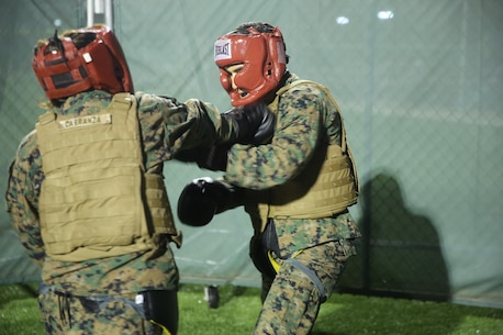 Cpl. Naylei Carranza, a supply clerk with Special Purpose Marine Air-Ground Task Force Crisis Response-Africa, lands a devastating lead hand punch during a sparring bout at Naval Air Station Sigonella, Italy, Sept. 30, 2016.  Marines with SPMAGTF-CR-AF completed a three-week long brown belt course for the Marine Corps Martial Arts Program.  (U.S. Marine Corps photo by 1st Lt. Eric Abrams/released)