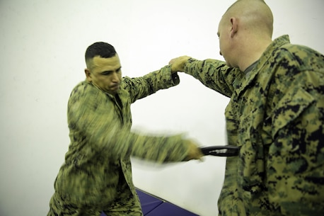 Gunnery Sgt. Carlos Jarquin, a supply chief with Special Purpose Marine Air-Ground Task Force Crisis Response-Africa, blocks a punch and performs a forward knife thrust at Naval Air Station Sigonella, Italy, Sept. 30, 2016.  Marines with SPMAGTF-CR-AF completed a three-week long brown belt course for the Marine Corps Martial Arts Program.  (U.S. Marine Corps photo by Cpl. Alexander Mitchell/released)