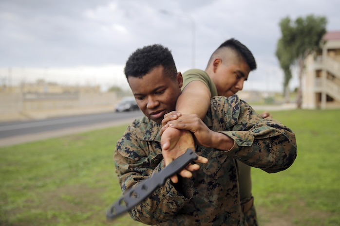 Cpl. David Hart, an ammunition chief with Special Purpose Marine Air-Ground Task Force Crisis Response-Africa, demonstrates proper technique to counter a knife attack at Naval Air Station Sigonella, Italy, Oct. 13, 2016.  Marines with SPMAGTF-CR-AF completed a three-week long brown belt course for the Marine Corps Martial Arts Program.  (U.S. Marine Corps photo by Cpl. Alexander Mitchell/released)
