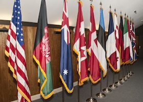 National flags representing the 13 countries that attended the 2015 Warrior Care in the 21st Century symposium were on display at the event in Bethesda, Md. The second annual symposium, scheduled in Tampa, Fla., Oct. 25-27, 2016, will provide the next in-person forum for participating nations to elevate and address key challenges to warrior care. Courtesy photo