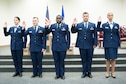 The 403rd Wing's newest staff sergeants swear the noncomissioned officer oath of induction during a ceremony at the Roberts Consolidated Aircraft Maintenance facility Oct. 16. (U.S. Air Force photo/Senior Airman Heather Heiney)