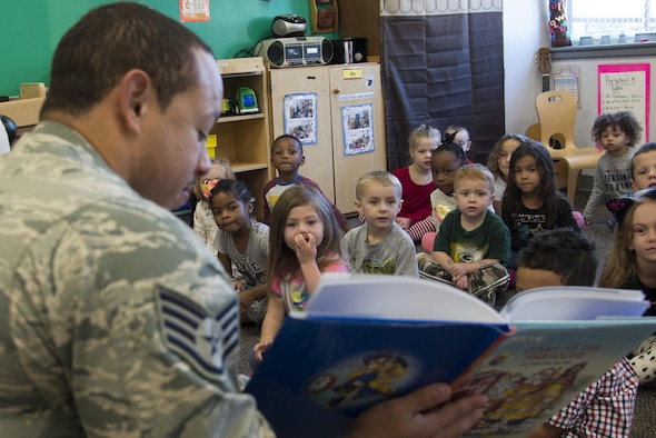 Staff Sgt. Julio Madera, 436th Civil Engineer Squadron Fire Department lead fire inspector, reads to children during Fire Prevention Week Oct. 14, 2016, at the Child Development Center on Dover Air Force Base, Del. The department led approximately 10 public events during the week to share fire prevention with Team Dover members. (U.S. Air Force photo by Senior Airman Aaron J. Jenne)