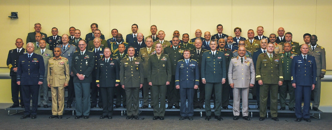 Senior military leaders from 50 countries pose for a group photo during the Chiefs of Defense Conference on Joint Base Andrews, Md., Oct. 17, 2016. The conference is an annual event where CHODs come together to discuss important global matters. (U.S. Air Force photo by Airman 1st Class Valentina Lopez)