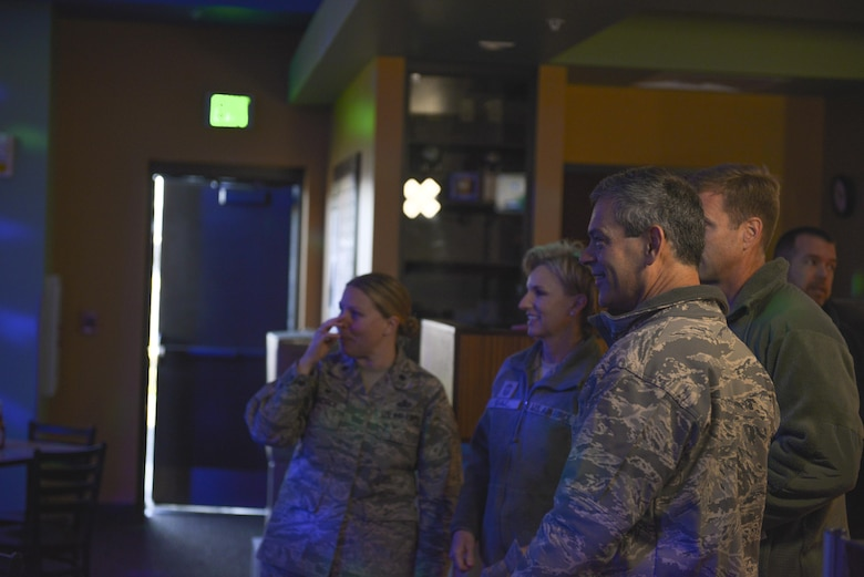 U.S. Air Force Lt. Gen. Ken Wilsbach, the 11th Air Force commander, take a tour of the bowling alley Oct. 13, 2016, at Eielson Air Force Base, Alaska. The bowling alley opened Sept. 13, 2016, and is one of the many places that allows Icemen and their family members an opportunity to mitigate the cold and darkness. (U.S. Air Force photo by Airman Isaac Johnson)