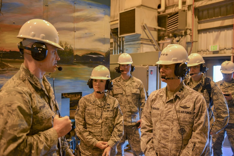 U.S. Air Force Chief Master Sgt. Gay Veale, the 11th Air Force command chief, and Lt. Gen. Ken Wilsbach, the 11th Air Force commander, walk through the Central Heat and Power Plant (CHPP) Oct. 13, 2016, at Eielson Air Force Base, Alaska. The CHPP uses coal to provide heat and power throughout Eielson, which is vital for sustainment in extreme cold-weather conditions. (U.S. Air Force photo by Airman Isaac Johnson)