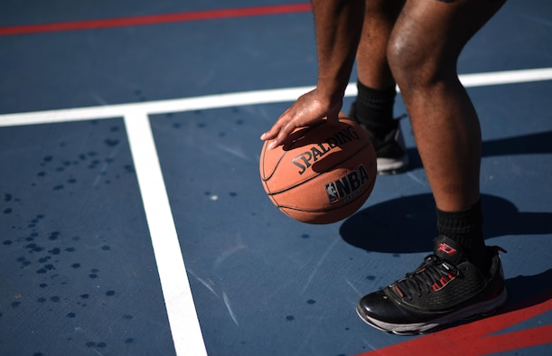 Airman 1st Class Daryl Parker, 608th Air Operations Center offensive duty technician, dribbles a basketball as part of his warm-up drills at Barksdale Air Force Base, La., Oct. 12, 2016. Parker started playing basketball at a young age and continues to maintain his physical fitness on the court. (U.S. Air Force photo/Senior Airman Damon Kasberg)