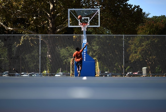 Airman 1st Class Daryl Parker, 608th Air Operations Center offensive duty technician, shoots a basketball at Barksdale Air Force Base, La., Oct. 12, 2016. Parker spends his free time improving his basketball skills to earn a spot on the All-Air Force Men's Basketball Team. (U.S. Air Force photo/Senior Airman Damon Kasberg)