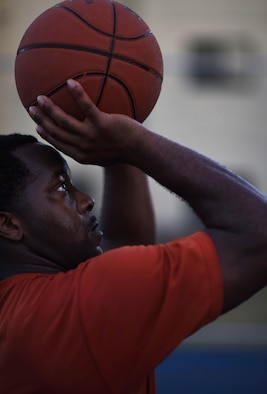 Airman 1st Class Daryl Parker, 608th Air Operations Center offensive duty technician, lines up his shot at Barksdale Air Force Base, La., Oct. 12, 2016. Parker was 1 of 29 Airmen selected to try out for the All-Air Force Men's Basketball Team. (U.S. Air Force photo/Senior Airman Damon Kasberg)