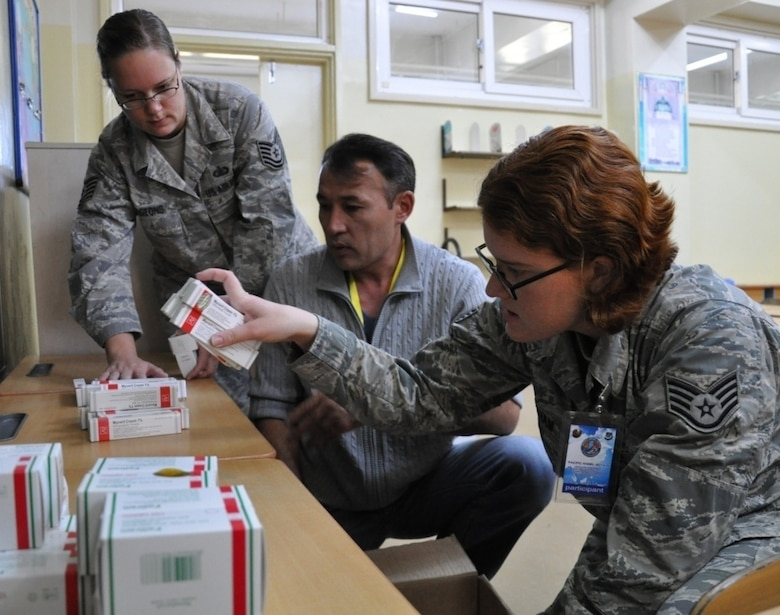 From left, then-Tech. Sgt. Maria Hudgeons,  the current 22nd Comptroller Squadron finance flight chief, a Mongolian translator and Staff Sgt. Nadine Statham, assigned to the 354th Medical Support Squadron, count pharmaceuticals in preparation for a health services outreach site in Erdenet, Mongolia, Aug. 13, 2014, during Pacific Angel-Mongolia 14-4. Hudgeons, now a master sergeant, is part of the Language Enabled Airman Program which uses developmental classes to build upon the abilities of Airmen who speak multiple languages and are familiar with the culture. (U.S. Air Force photo/Capt. Justin Billot)