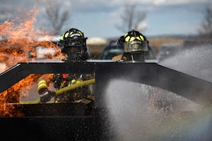 PETERSON AIR FORCE BASE, Colo. – Firefighters from Peterson Fire and Emergency Services put out a car fire during a demonstration at the base exchange on Peterson Air Force Base, Colo., Oct. 11, 2016. It was one of many events held throughout National Fire Prevention Week to educate the base populace about the importance of fire safety. (U.S. Air Force photo by Senior Airman Rose Gudex)