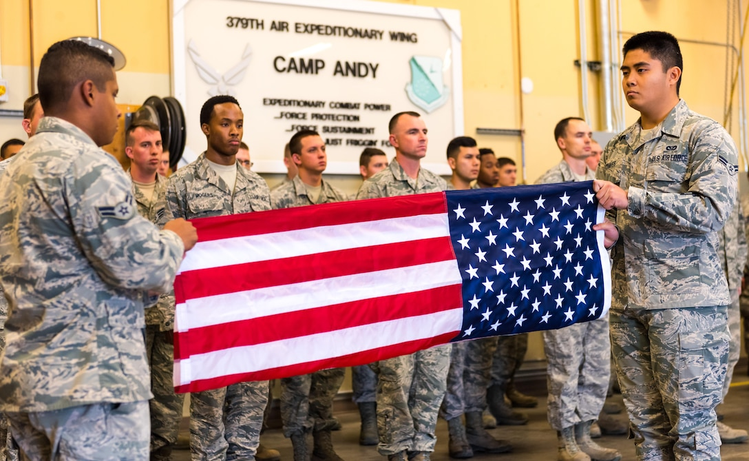 Airmen, assigned to the 366th Civil Engineer Squadron, fold a flag at the annual remembrance ceremony of Master Sgt. Evander Andrews at Mountain Home Air Force Base, Idaho. Andrews was the first casualty in the War on Terror after the attacks on 9/11 when he lost his life while building a runway in Qatar.