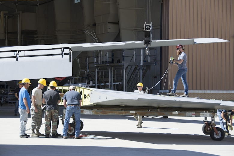 Members of the 507th Maintenance Squadron and the 564th Aircraft Maintenance Squadron work together to install a vertical stabilizer on a KC-135 Stratotanker following rudder and stabilizer repair Sept. 27, 2016. The two squadrons worked together to complete the task, normally performed at the Oklahoma City Air Logistics Complex. (U.S. Air Force photo by Tech. Sgt. Lauren Gleason)