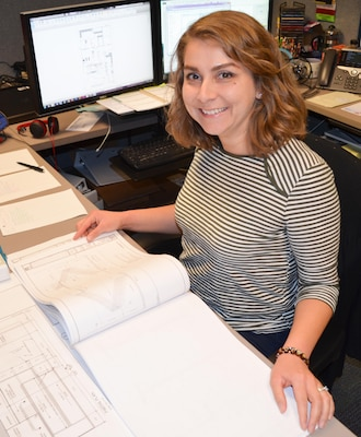 Sacramento District architect Mickela Pallares works at her desk Oct. 14, 2016.