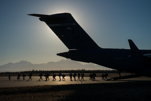 U.S. Airmen assigned to the 621st Contingency Response Wing guide Soldiers with the 4th Brigade Combat Team (Airborne), 25th Infantry Division as they exit a C-17 Globemaster III aircraft during exercise RED FLAG-Alaska 17-1, Oct. 13, 2016. RF-A is a series of Pacific Air Forces commander-directed field training exercises for U.S. and partner nation forces, providing combined offensive counter-air, interdiction, close air support, and large force employment training in a simulated combat environment. (U.S. Air Force photo by Master Sgt. Joseph Swafford)