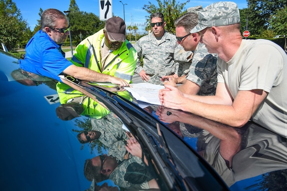 Citizen Airmen from the 116th Air Control Wing, Georgia Air National Guard, meet with supervisors from the Chatham County Public Works to plan road-clearing operations for the day during cleanup in the aftermath of Hurricane Matthew, Savannah, Ga., Oct. 10, 2016. The Airmen deployed to Savannah to support civil authorities working along side the Chatham County Public Works department to assist in road clearing and debris cleanup operations. (U.S. Air National Guard photo by Senior Master Sgt. Roger Parsons)