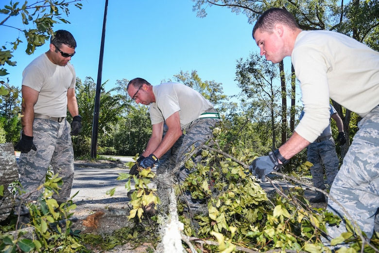 Citizen Airmen from the 116th Air Control Wing, Georgia Air National Guard, clear a tree out of a roadway during road-clearing operations in the aftermath of Hurricane Matthew, Savannah, Ga., Oct. 10, 2016. The Airmen deployed to Savannah to support civil authorities working along side the Chatham County Public Works department to assist in road clearing and debris cleanup operations. (U.S. Air National Guard photo by Senior Master Sgt. Roger Parsons)