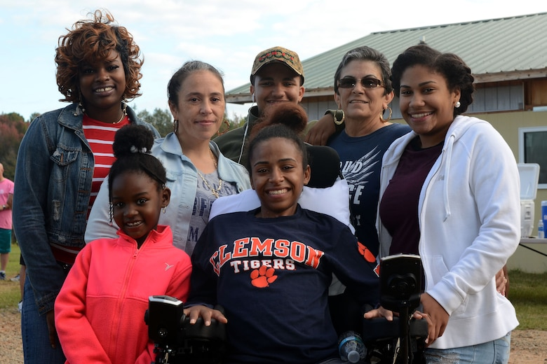 U.S. Air Force Airman 1st Class Jamia Porcher, an aircraft electrician assigned to the 169th Maintenance Squadron, and family at the 6th annual Foxtrot Warrior Run at McEntire Joint National Guard Base, S.C., Oct. 16, 2016.  The fundraiser event raised money for the Warm Heart Association to benefit Porcher, an aircraft electrician assigned to the 169th Maintenance Squadron, and other South Carolina Wounded Warrior charities.   (U.S. Air National Guard photo by Senior Airman Ashleigh Pavelek)