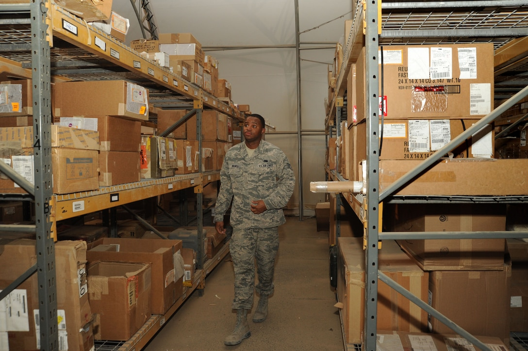 Staff Sgt. Terrance Branch, 386th Expeditionary Logistics Readiness Squadron materiel management journeyman, looks for a part in the aircraft parts store warehouse Oct. 13, 2016 at an undisclosed location in Southwest Asia. Branch is a member of the APS team that is responsible for storing and issuing parts for nine weapon systems within their shops responsibility. (U.S. Air Force photo/Senior Airman Zachary Kee)