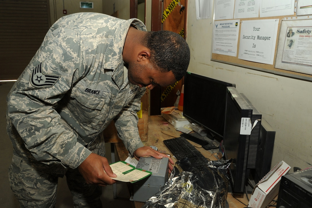 Staff Sgt. Terrance Branch, 386th Expeditionary Logistics Readiness Squadron materiel management journeyman, verifies a serial number on an aircraft part Oct. 13, 2016 at an undisclosed location in Southwest Asia. The aircraft parts store is responsible for stocking and issuing weapon system spares to aircraft maintainers and coordinating with the states to send back broken parts that need fixed. (U.S. Air Force photo/Senior Airman Zachary Kee)