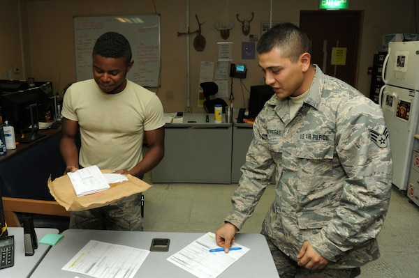 Senior Airman Nicholas Contreras, left, 386th Expeditionary Logistics Readiness Squadron materiel management journeyman, and Senior Airman Dominique Corbin, 386 ELRS traffic management journeyman, prepare an aircraft part for shipment Oct. 13, 2016 at an undisclosed location in Southwest Asia. The aircraft parts store coordinates with TMO to send needed parts to locations throughout the area of responsibility. (U.S. Air Force photo/Senior Airman Zachary Kee)