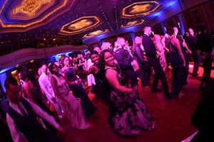 In the center of the dance floor, Air Force Tech Sgt. Saleisa Lampkin, left, and Petty Officer 1st Class Diamond Cameron, right, dance together and pose for the camera during the 2016 Navy Ball at the Gulf Hotel Convention Center in Manama, Bahrain. The Navy Ball is an annual event, which celebrates the heritage, history and the day Congress created the United States Navy on Oct. 13, 1775. The U.S. Navy has a 241-year heritage of defending freedom and projecting and protecting U.S. interests around the globe.