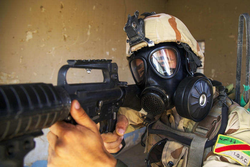 An Iraqi soldier attending the advanced infantry course provides security during chemical, biological, radiological and nuclear defense training at Camp Taji, Iraq, Oct. 9, 2016. This training helps Iraqi soldiers understand and defend against CBRN threats. This training is critical to enabling ISF to counter Islamic State of Iraq and the Levant as they work to regain territory from the terrorist group and support Combined Joint Task Force - Operation Inherent Resolve's building partner capacity mission. (U.S. Army photo by Spc. Craig Jensen)