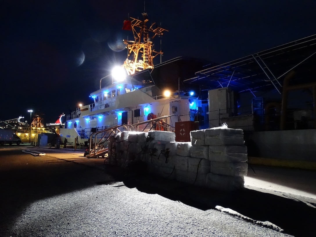 The crew of the Coast Guard Cutter Heriberto Hernandez offloads 2,367 pounds of cocaine following the interdiction of a vessel north of Puerto Rico, Aug. 28, 2016. While fighting the drug trade remains important, the commander of U.S. Southern Command told a National Defense University audience Oct. 18, 2016, that increasing regional cooperation, real-time information sharing and multinational operations is necessary to overcoming a variety of transregional and transnational networks that threaten security and stability. Coast Guard photo by Ricardo Castrodad