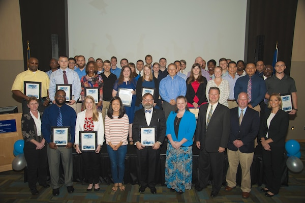 Naval Surface Warfare Center Dahlgren Division (NSWCDD) employees honored at the command's 2016 academic awards ceremony are pictured after the event where they were commended for successfully taking on the challenges of balancing work and family responsibilities with academics to obtain certifications or degrees. In addition to core engineering disciplines – mechanical, electrical and systems engineering – this year's graduates earned degrees in areas such as aerospace engineering, cybersecurity, national security and strategic studies, contract management, operations research, applied physics, and biochemistry.