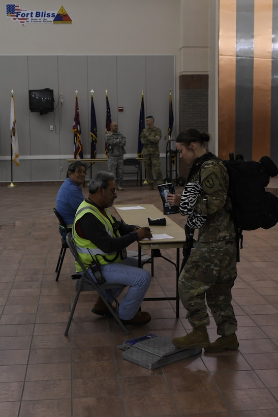 A Soldier assigned to the 785th MP Bn., is weighed at the Silas L. Copeland Arrival/Departure Airfield Control Group here Oct. 3.