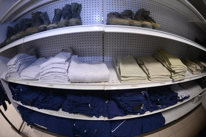 Air Force uniform items sit on a shelf in the Airman's Attic at Aviano Air Base, Italy on Oct. 19, 2016. The Airman's Attic supports military members E-5 and below and their family members with a variety of household goods and clothing items with the exception of uniform items which are available for all ranks. (U.S. Air Force photo by Staff Sgt. Andrew M. Satran/Released)