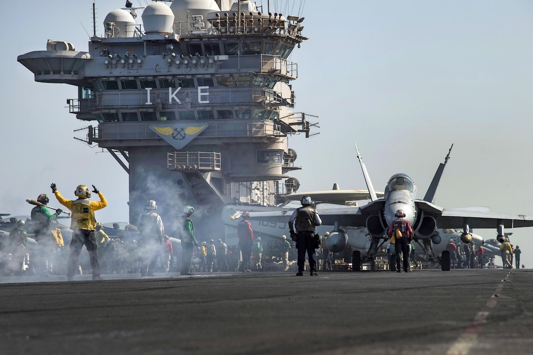 An F/A-18C Hornet aircraft taxis toward a bow catapult on the flight deck of the aircraft carrier USS Dwight D. Eisenhower in the Persian Gulf, Oct. 16, 2016. The pilots and aircraft are assigned to Strike Fighter Squadron 131. The Eisenhower and its Carrier Strike Group are deployed in support of Operation Inherent Resolve, maritime security operations and theater security cooperation efforts in the U.S. 5th Fleet area of operations. Navy photo by Seaman Christopher A. Michaels