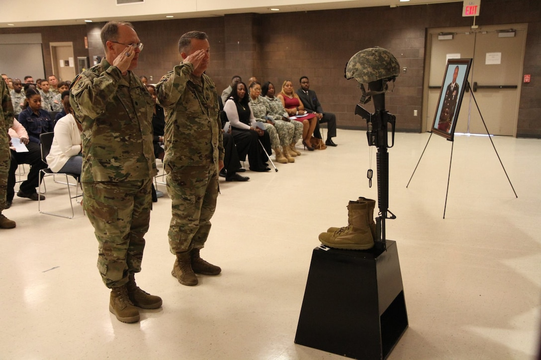 3d MCDS Chaplains render final salutes during the memorial ceremony held in honor of Master Sgt. Steven Graham.