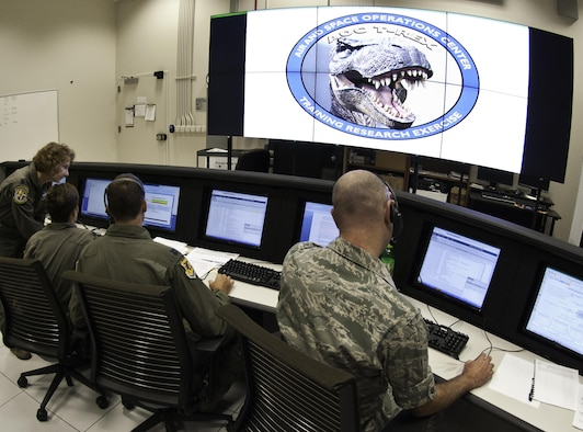 Analysts participate in a training research exercise, or T-REX, created by the 711th Human Performance Wing's Warfighter Readiness Research Division at Wright-Patt. These trainings better equip analysts by simulating real-world intelligence fusion/collaboration, and test the integration of multiple research and development testbeds. (U.S. Air Force photo by Richard Eldridge)