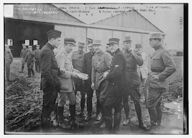 "Members of the Lafayette Escadrille hold a mission briefing in France, June 26, 1916. From left, Kiffin Yates Rockwell (1892-1916); Lt. Col. Georges Thenault, commander of the Lafayette Escadrille; Norman Prince (1887-1916); Lt. Alfred de Laage de Meux; Sgt. Elliot Cowdin; Sgt. Weston Birch ""Bert"" Hall; James Rogers McConnell (1887-1917); and Victor Chapman. Library of Congress photo"