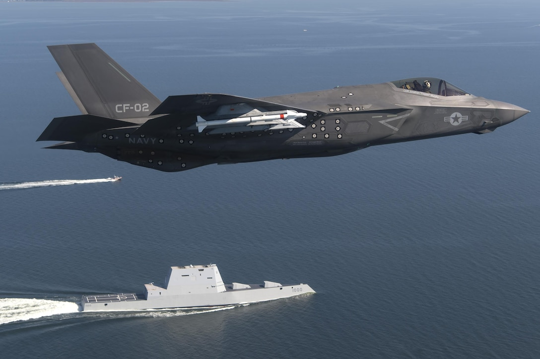 An F-35 Lightning II flies over the USS Zumwalt in the Chesapeake Bay in Maryland, Oct. 17, 2016. The aircraft is assigned to the F-35 Lightning II Pax River Integrated Test Force. The Zumwalt, the world's largest and most technologically advanced surface combatant, is the lead ship of a class of next-generation multi-mission destroyers. Navy photo by Andy Wolfe