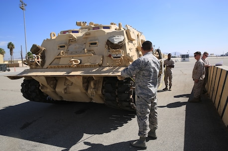 U.S. Marines and Airmen conduct a joint-inspection of an M-88A2 HERCULES at March Air Force Reserve Base, Calif., Oct. 13, 2016. The inspection is to ensure that the vehicle can safely be flown on the C-17 Globemaster III  to Marine Corps Air Ground Combat Center Twentynine Palms, Calif. In the joint-inspection Marines and Airmen check the center of balance, hazardous material and cleanliness of the vehicle.