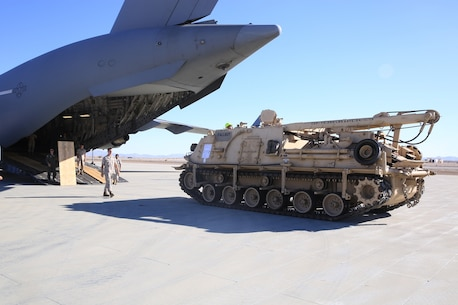 U.S. Marines and Airmen unload the M-88A2 HERCULES at Marine Corps Air Ground Combat Center Twentynine Palms, Calif., Oct. 14, 2016. Transporting the M-88A2 from March Air Force Reserves Base, Calif., to Combat Logistics Company 13 in Twentynine Palms, helped the aircrew for the C-17 Globemaster III meet quarterly requirements.