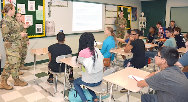 (From left) Staff Sgt. Devon Modrak animal care specialist, Capt. Daniela Roberts, veterinarian, and Sgt. Robyn Rothwell, animal care specialist, speak to a room of Cole High School Students during the school's career day Oct. 7. The event hosted both civilian and military career professionals who spoke on occupations such biochemistry, nursing, legal, veterinary science and engineering.