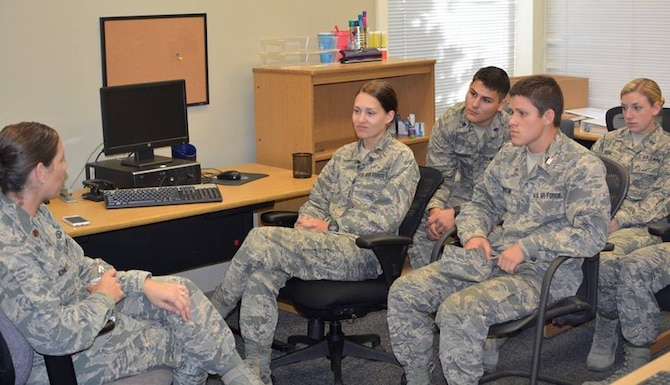 Air Force ROTC cadets listen to Maj. Erika Chute, ACSC Gathering of Eagles member, during the ROTC detachment's career day Oct. 13th at Auburn University.  Approximately 20 ACSC students from various career fields attended the career day to help cadets learn more about career opportunities in the Air Force.  (US Air Force photo by LCDR Thomas Griffin)