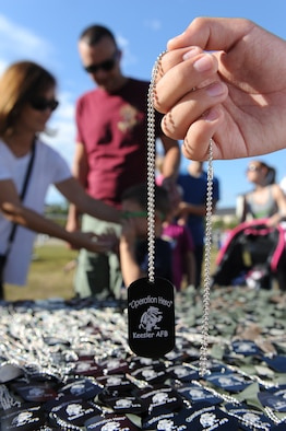 Ruben Cerda, Jr., son of Ruben Cerda, 81st Force Support Squadron airman and family services flight chief, holds a dog tag during Operation Hero Oct. 15, 2016, on Keesler Air Force Base, Miss. The event was designed to help children better understand what their parents do when they deploy. (U.S. Air Force photo by Kemberly Groue/Released)