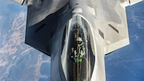 <strong>Photo of the Day: Oct. 20, 2016</strong><br/><br />An Air Force F-22 Raptor receives fuel from a KC-135 Stratotanker while both units participate in Vigilant Shield 2017, a field training exercise, in the high Arctic, Oct. 18, 2016. The North American Aerospace Defense Command sponsored the annual exercise to improve operational capability in a binational environment. The Raptor is assigned to Joint Base Elmendorf-Richardson, Alaska. Pilots from the 92nd Aerial Refueling Squadron, assigned to Fairchild Air Force Base, Wash., flew the Stratotanker. Air Force photo by Tech. Sgt. Gregory Brook<br/><br /><a href=&quot;http://www.defense.gov/Media/Photo-Gallery?igcategory=Photo%20of%20the%20Day&quot;> Click here to see more Photos of the Day. </a>