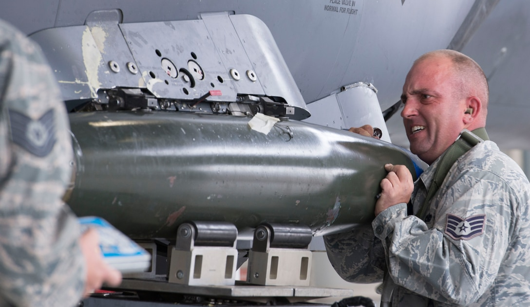 Staff Sgt. Dylan J. Peterson, 391st Aircraft Maintenance Unit weapons load crew team chief, secures a training munition to his team's F-15E Strike Eagle during a load competition Oct. 14, 2016, at Mountain Home Air Force Base, Idaho. Each squadron chooses their best three airmen to participate in this quarterly event.