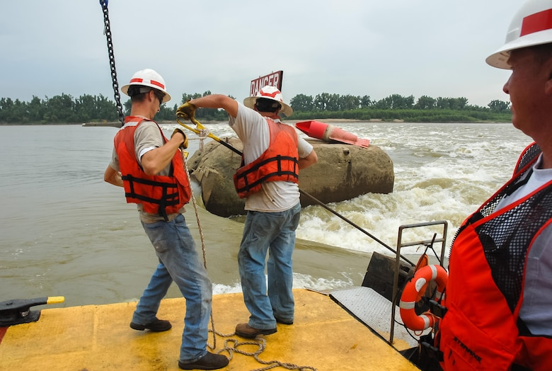 Staff at Locks and Dam 52 on the lower Ohio River work to raise a wicket on the 1920s-era dam.